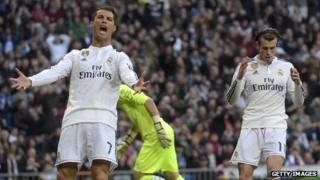 Real Madrid's Cristiano Ronaldo (L) and Gareth Bale