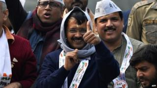Aam Aadmi Party (AAP) party chief Arvind Kejriwal greets supporters during a road show in New Delhi on January 20, 2015