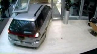 Car smashing the doors at Red Bull, Milton Keynes