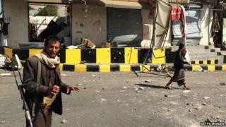 Armed Houthi in street in Sanaa