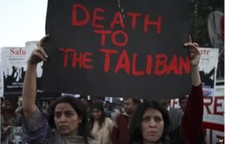 "Activists of Pakistan""s civil society groups condemn the Taliban's attack on a military-run school in Peshawar, during a rally in Lahore, Pakistan, Friday, Jan 16"