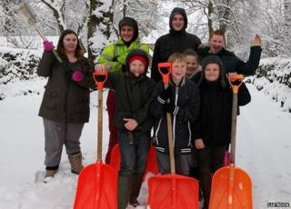 Children helping clear the snow