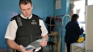 police officer investigates a crime scene
