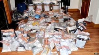 The police released a photograph of the cash and drugs seized in Newtownabbey overnight