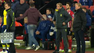 An Arsenal fan confronts Arsene Wenger