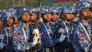 Myanmar soldiers march in formation during the 67th Myanmar Independence Day Grand Military Review parade in Naypyidaw on January 4, 2015.