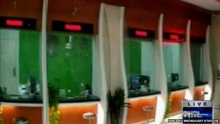 Chinese TV footage of inside the bank showing the counters