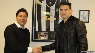 Jim Rodwell shakes hands with Balint Bajner