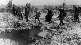 British Troops in France going 'up the line' to their trenches through the mud in the 1914-1918 First World War