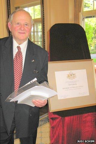 Frank Vajda next to a certificate making Raoul Wallenberg Australia's first and only honorary citizen.