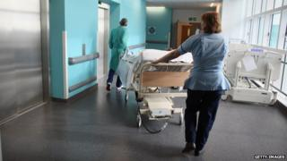 Hospital staff moving a patient