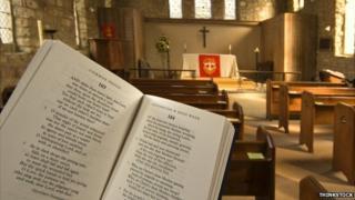 Prayer book held up inside an Anglican church
