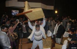 A constitution assembly member of an opposition party throws a chair during a meeting inside the Constitution Assembly building in Kathmandu January 20, 2015.