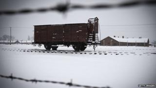 Snows falls on a train car at the memorial site of the former Nazi concentration camp Auschwitz-Birkenau.