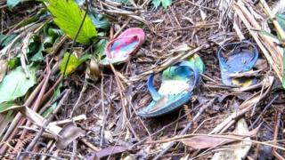 Abandoned sandals in the bush in Burundi (January 2015)