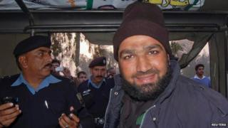 Mumtaz Qadri smiles after being detained at the site of Taseer's shooting in Islamabad 4 January 2011