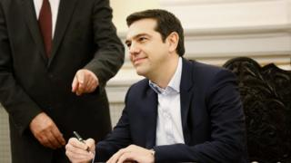 """Alexis Tsipras, Syriza party leader, signs papers appointing him as Greece""""s prime minister."""