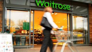 Shopper with trolley outside Waitrose