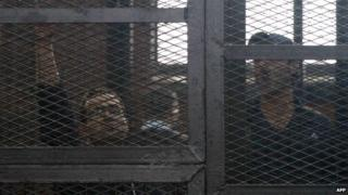 Egyptian prominent activists Ahmed Douma (R) and Ahmed Maher (L)react as they stand in the dock during their failed appeal on 7 April 2014
