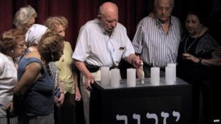Holocaust survivors light candles at the AMIA community centre BA, 27 Jan 2015