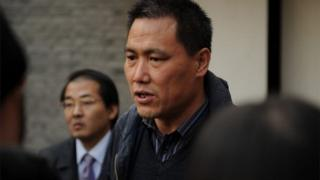 Pu Zhiqiang (C), the lawyer for Chinese artist Ai Weiwei, talks to the media at the artist's studio in Beijing on November 14, 2011.