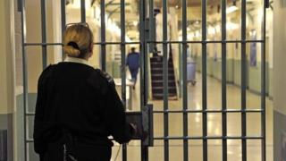Prison officer locking gates