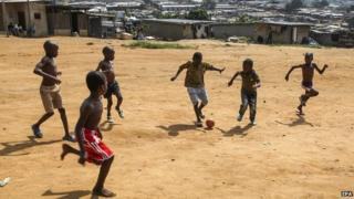 Children playing football in Abidjan