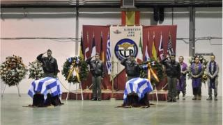 Compatriots salute the coffins of the two Greek pilots who died on 26 January in the plane accident at Los Llanos air base in Albacete.