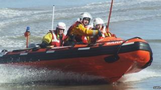 A SARA lifeboat and crew in action