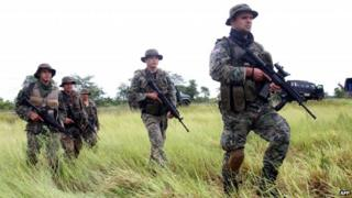 Members of the joint task forces patrol near Concepcion, Paraguay after the deaths of two German ranchers Jan 29 2015