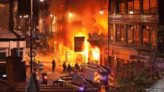 Firefighters tackle a blaze during riots in London in 2011