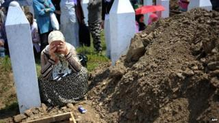 A Bosnian Muslim woman cries during a mass burial for 775 newly identified victims of the 1995 Srebrenica massacre at the Srebrenica Memorial Cemetery in Potocari, Bosnia and Herzegovina, on 11 July 2010