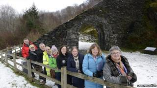 Conservation team and slate arch