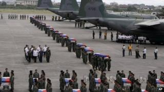 Philippine National Air Force transport coffins of 44 police commandos killed on Sunday