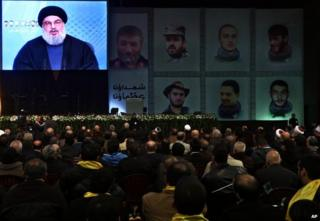 Hassan Nasrallah speaks from a screen in Beirut, 30 January