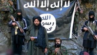 Propaganda video still showing leader of IS in Khorasan