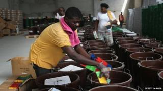 "A Unicef worker assembles ""school infection prevention kits"" to stop the spread of Ebola in schools in Monrovia. Photo: 28 January 2015"