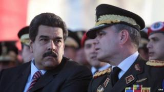 Venezuelan President Nicolas Maduro (L) and Minister of Defence Vladimir Padrino Lopez (R), during a graduation of troop officials in Caracas, Venezuela, 27 January 2015