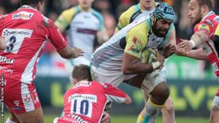 Tevita Cavubati of Ospreys is tackled by Billy Burns of Gloucester