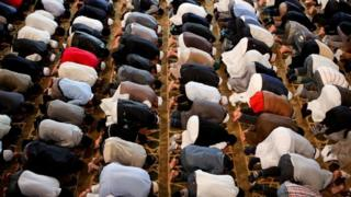 Men praying in East London Mosque