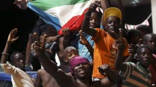 Equatorial Guinea fans celebrate on a street in Malabo, Equatorial Guinea after their national team beat Tunisia at their Africa Cup of Nations quarterfinal match, Saturday 31 January 2015