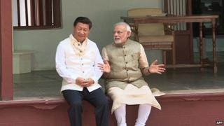 Mr Xi (left) wore a traditional Indian jacket gifted to him by Mr Modi (right) in September