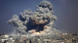 Smoke rises above Gaza after an Israeli air strike - 29 July 2015