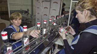 Employees at a Russian vodka distillery