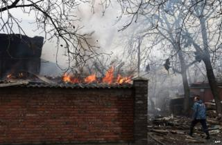 A house burns in the city of Donetsk after shelling, 3 February