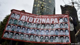 Relatives of the 43 missing students hold a poster during a protest march in Mexico City on 6 January, 2015.