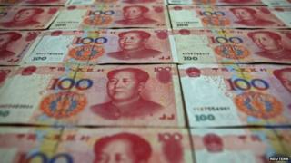 Chinese 100 yuan banknotes are seen in Beijing 7 May 2013.