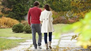 A couple walking along talking