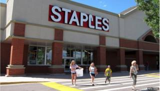 Staples store with family out front