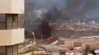 In this file image made from video posted by a Libyan blogger, the Corinthia Hotel is seen under attack in Tripoli, Libya, Tuesday, Jan. 27, 2015.